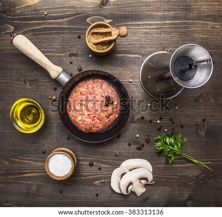 raw cutlet burger for a small frying pan, seasoning, butter, mushrooms, parsley on wooden rustic background top view close up - stock photo