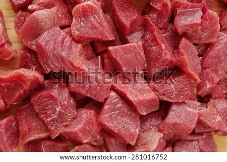 Raw cutting beef on wooden plate  - stock photo