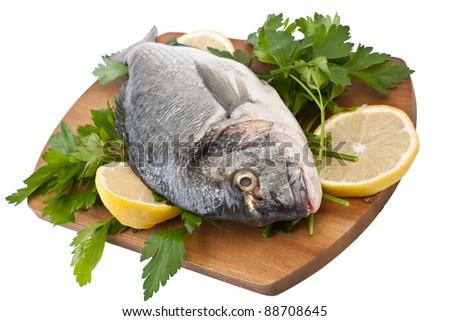 Raw dorado fish with herbs and lemon isolated on white background - stock photo