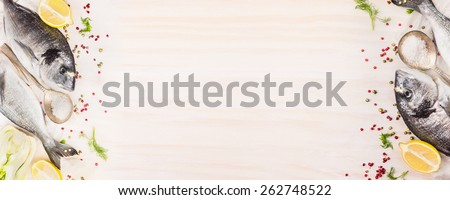 Raw dorado fish with lemon, herb and spices on white wooden background, top view, banner for website with cooking concept, place for text - stock photo