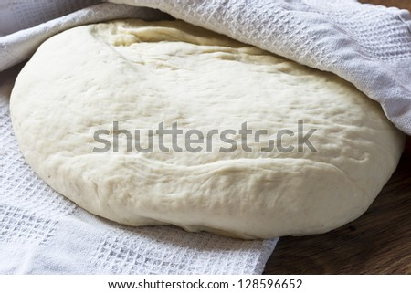 raw dough on a wooden table for cooking dumplings - stock photo