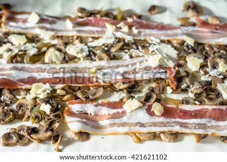 Raw dough with mushroom and bacon stuffing. Preparing french pastry snacks