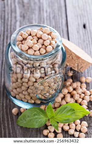 Raw dry chickpeas in a glass jar - stock photo
