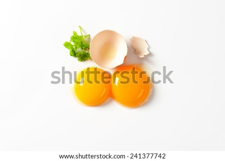 Raw egg yolk on white background - stock photo