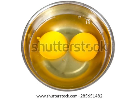 Raw eggs in bowl - stock photo