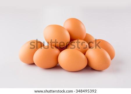 raw eggs isolated on white background - stock photo