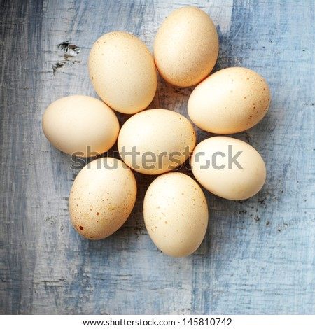 raw eggs on a wood table - stock photo