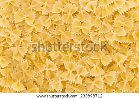 Raw Farfalle (also known as Bow-Tie Pasta) close-up shot for use as background image or as texture - stock photo