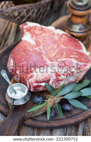 Raw fiorentina steak ( t-bone, porterhouse ) - stock photo