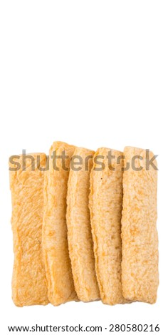 Raw fish fingers or fish stick over white background