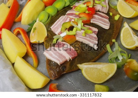 raw fish flounder with vegetable and bacon - stock photo