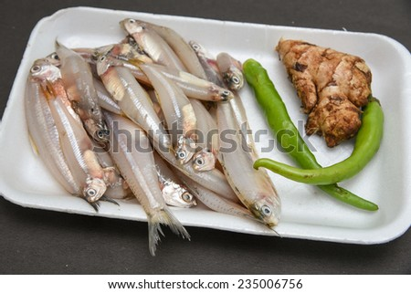 Raw Fish ready to cook with ginger onions and green chili. silver fish - stock photo