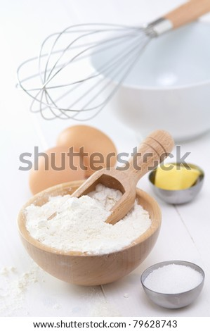 raw food, flour, eggs, sugar, butter to make a cake - stock photo