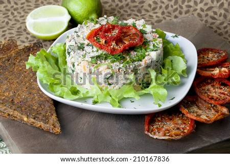 raw food Salad with dried tomatoes in a still life - stock photo