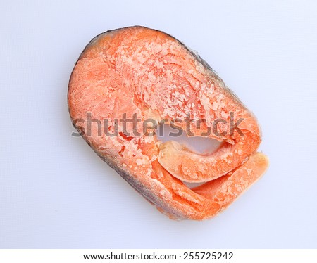 Raw freezed sliced salmon prepared for cooking on white background - stock photo