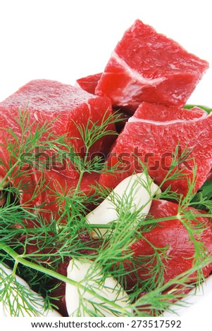 raw fresh beef meat slices in a white bowls with dill and green hot peppers isolated over white background - stock photo