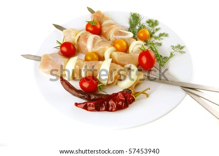 raw fresh chicken shish kebab on white plate - stock photo