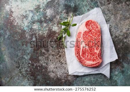 Raw fresh marbled meat Black Angus Steak Ribeye on metal background - stock photo