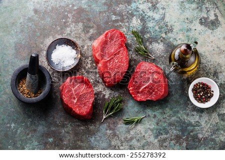 Raw fresh marbled meat Steak and seasonings on metal background - stock photo