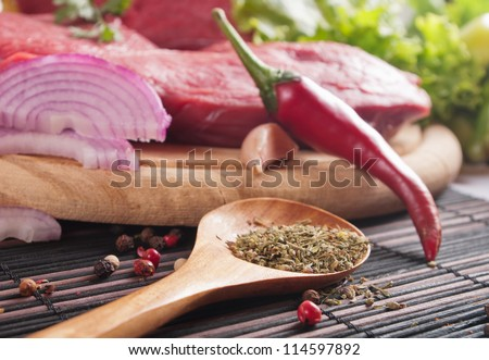 Raw fresh meat on board - stock photo