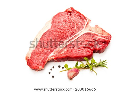 Raw fresh meat T-bone steak and seasoning isolated on white background - stock photo