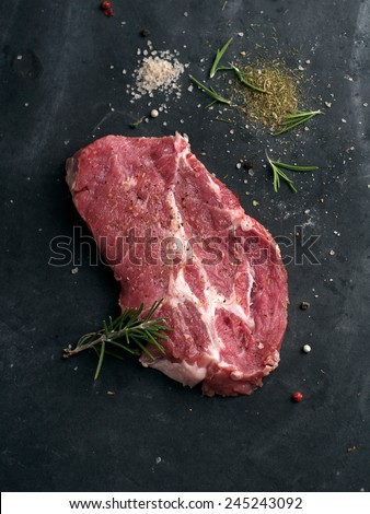 Raw fresh meat with spices, selective focus - stock photo
