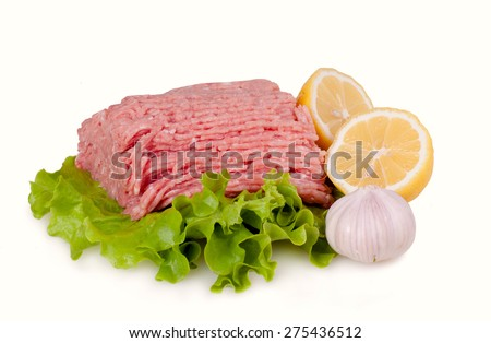 Raw fresh minced meat with salad isolated on white background