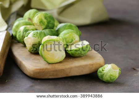 raw fresh organic brussels sprouts on cutting board - stock photo