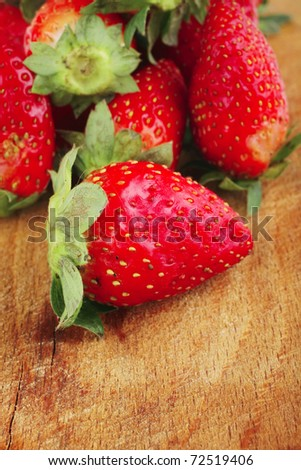 raw fruits: fresh ripe strawberry over wooden plate shallow dof - stock photo