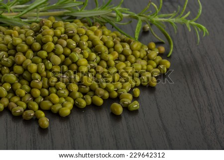 Raw green beans on the desk - stock photo
