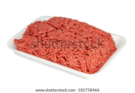 Raw ground beef in a white polystyrene tray isolated on a white background. Suitable for illustrating contaminated or recalled ground beef. - stock photo