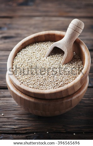 Raw healthy quinoa on the wooden table, selective focus