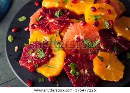 Raw Homemade Citrus Salad with Grapefruit and Oranges - stock photo