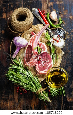 Raw lamb cutlets with vegetables, herbs and spices - stock photo