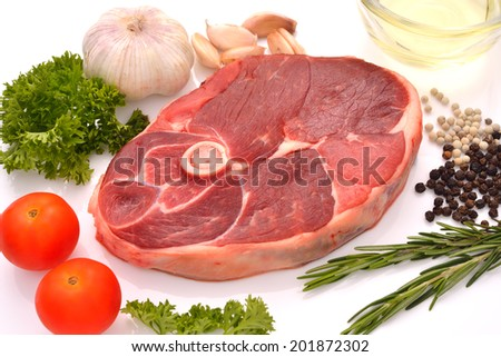 Raw lamb leg ready to be cooked isolated on white. - stock photo