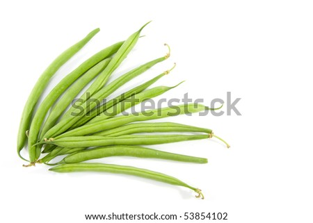 raw long green beans over white background