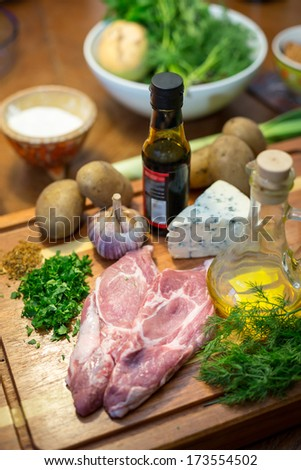raw meat, cheese, potatoes and different ingredients - stock photo