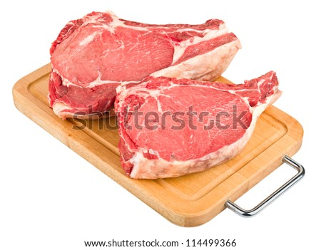 raw meat : fresh beef pork big rib and fillet on wooden board on diagonally, isolated over white background - stock photo