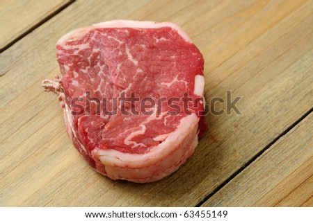 Raw meat-isolated raw beef on the wooden table