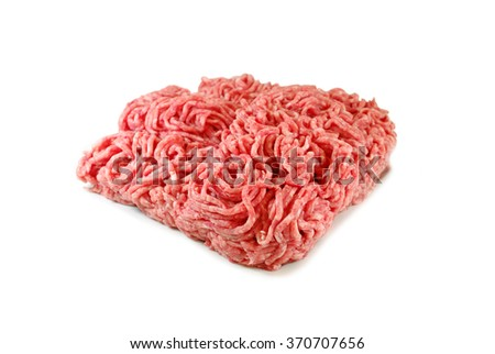 Raw meat. Minced pork in a plate isolated on white background