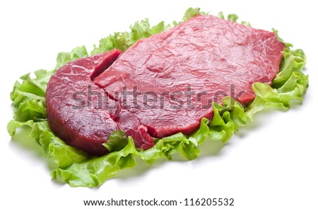 Raw meat on lettuce leaves. Isolated on white. - stock photo