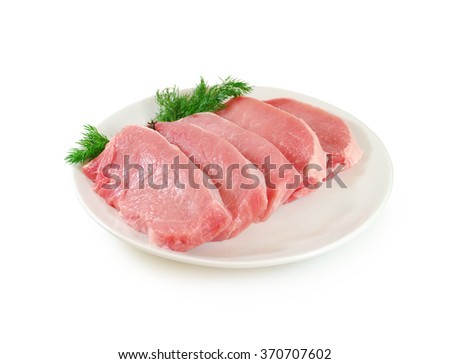 Raw meat. Pork steak with dill in a plate  - stock photo
