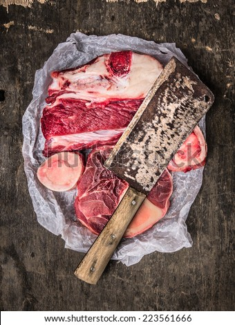 raw Meat set for soup with vintage cleaver on dark background , top view - stock photo