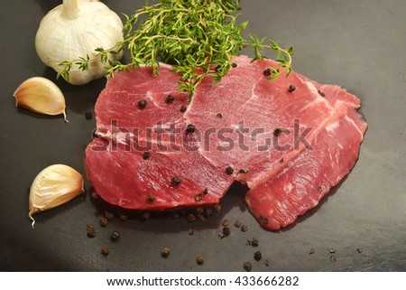 raw meat with food ingredient tabletop  - stock photo