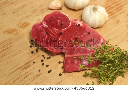 raw meat with spices and ingredient on chopping board - stock photo