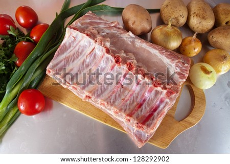Raw meat with vegetables on cook table