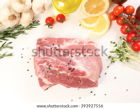 raw meat with vegetables on table