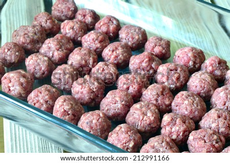 Raw meatballs fresh juicy meat on the table. - stock photo