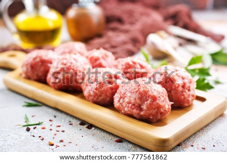 raw meatballs with aroma spice and on a table