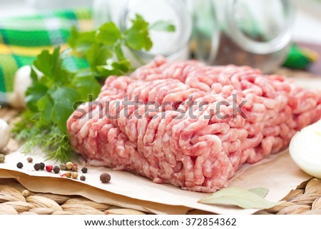Raw minced meat on the table - stock photo